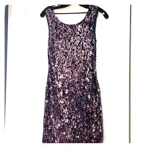 Backless silver sequined dress.